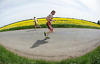 26 MAY 2013 - BRIGG, GBR - Competitors run through the Lincolnshire countryside during the 2013 Brigg Bomber Quadrathlon, a World Quadrathlon Federation World Cup round and the British Championships, held in Brigg in Lincolnshire, Great Britain .(PHOTO (C) 2013 NIGEL FARROW)