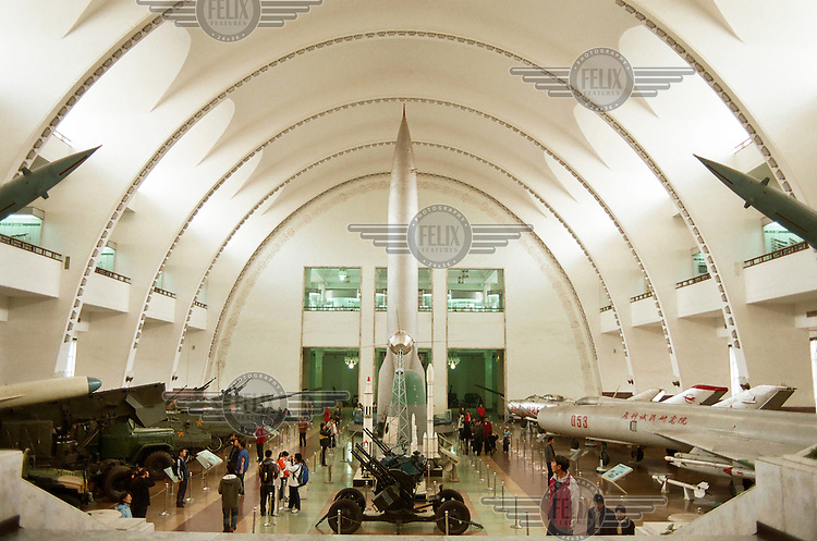 Missiles, warplanes and military vehicles in the main hall of the China People's Revolution Military Museum.