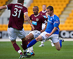 St Johnstone v Hearts...25.09.11   SPL Week 9.Chris Millar tackles Adrian Mrowiec.Picture by Graeme Hart..Copyright Perthshire Picture Agency.Tel: 01738 623350  Mobile: 07990 594431