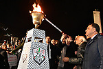 Palestinian president Mahmud Abbas lights an urn outside the tomb of the late President Yasser Arafat during a celebration marking the fifty-third anniversary of the creation of the Fatah movement in the West Bank city of Ramallah on December 31, 2017. Photo by Thaer Ganaim