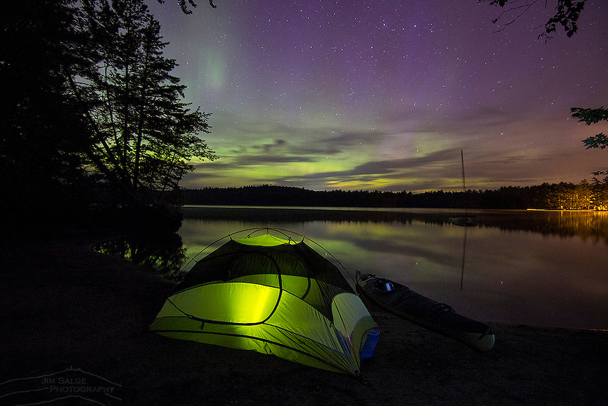 The northern lights dance above a campsite at White Lake State Park in the White Mountains of New Hampshire.