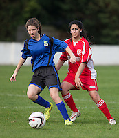 Hannah Cornish of Laurel Park Vipers takes the ball from Henna Hussain of Flackwell Heath during the Thames Valley Counties Women's Football League (TVCWFL) match between Flackwell Heath Ladies and Laurel Park Vipers at Wilks Park, Blackwell Heath, England on 11 October 2015. Photo by Andy Rowland.