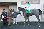2011 03 19: Quantum Miss and Cornelio Velasquez in the winners circle after winning the Grade 3 Cicada Stakes, for 3-year old fillies at 6 furlongs, on the inner dirt track, Aqueduct Racetrack, Jamaica, NY. Trainer Anthony Dutrow. Owner Daniel M. Ryan