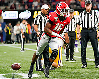 ATLANTA, GA - DECEMBER 7: Lewis Cine #16 of the Georgia Bulldogs after a presumed fumble recovery during a game between Georgia Bulldogs and LSU Tigers at Mercedes Benz Stadium on December 7, 2019 in Atlanta, Georgia.