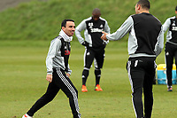 Swansea City FC, training session, Llandarcy, Swansea, 16/03/12<br /> Pictured: Leon Britton (left) shares a joke with Stephen Caulker<br /> Picture by: Ben Wyeth / Athena Picture Agency<br /> info@athena-pictures.com