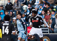 Bobby Convey (11) of Sporting Kansas City goes up for a header with Sheanon Williams (25) of  the Philadelphia Union during the game at PPL Park in Chester, PA.  Kansas City defeated Philadelphia, 3-1.