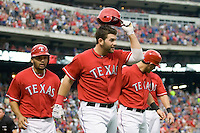 Texas Rangers first baseman Mitch Moreland (18) tips his helmet to the crowd after hitting a grand slam home run against the Oakland Athetics in American League baseball on May 11, 2011 at the Rangers Ballpark in  Arlington, Texas. (Photo by Andrew Woolley / Four Seam Images)