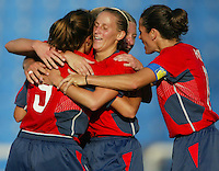 20 August 2004:  Kristine Lilly celebrates with Mia Hamm and Julie Foudy after Kristine scored a goal during the first half against Japan during the quarterfinals at Kaftanzoglio Stadium in Thessaloniki, Greece.     USA defeated Japan, 2-1 .   Credit: Michael Pimentel / ISI