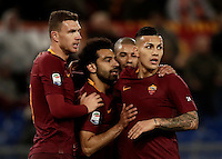 Calcio, Serie A: Roma, stadio Olimpico, 19 febbraio 2017.<br /> Roma's Mohamed Salah celebrates with his teammates Edin Dzeko Bruno Peres and Leandro Paredes after scoring during the Italian Serie A football match between As Roma and Torino at Rome's Olympic stadium, on February 19, 2017.<br /> UPDATE IMAGES PRESS/Isabella Bonotto