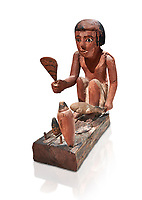 Ancient Egyptian wooden model of a man cooking a duck, New Kingdom, 11-13th Dynasty, (1980-1700 BC), Asyut. Egyptian Museum, Turin. Cat 8944. white background. <br /> <br /> Wooden tomb models were an Egyptian funerary custom throughout the Middle Kingdom in which wooden figurines and sets were constructed to be placed in the tombs of Egyptian royalty. These wooden models represented the work of servants, farmers, other skilled craftsman, armies, and religious rituals
