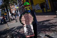 BOGOTA - COLOMBIA, 20-07-2021: Un joven de la primera línea, en el sector del barrio la Granja en Bogotá, porta un escudo artesanal con arengas al paro nacional hoy, 20 de julio de 2021, en Bogotá durante la conmemoración del día de independencia de Colombia en el cual siguen las protestas del paro nacional que nuevamente convocó movilizaciones para protestar por el gobierno del presidente Duque. / A young man from the front line, in the La Granja neighborhood sector in Bogotá, carries an artisan shield with harangues to the national strike today, July 20, 2021, in Bogotá during the commemoration of Colombia's independence day in which the protests of the national strike that again called mobilizations to protest the government of President Duque. Photo: VizzorImage / Diego Cuevas / Cont