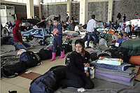 Pictured: Migrants are resting on the ground at the passenger terminal Thursday 03 March 2016<br />