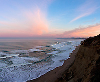 The sun rises in the east, but it paints the entire sky - north, west, all of it.  Sunrise glow along the California coast.