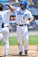 Asheville Tourists Matt Barefoot (12) is congratulated by Cesar Salazar (11) after hitting a home run during a game against the Greenville Drive on July 18, 2021 at McCormick Field in Asheville, NC. (Tony Farlow/Four Seam Images)
