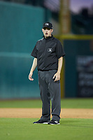 Umpire Sean Cassidy handles the calls on the bases during the South Atlantic League game between the Hickory Crawdads and the Ocelotes de Greensboro at First National Bank Field on June 11, 2019 in Greensboro, North Carolina. The Crawdads defeated the Ocelotes 2-1. (Brian Westerholt/Four Seam Images)
