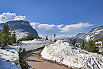 Snow lingers atLogan Pass Visitor Center, Going-to-the-Sun Road, Glacier National Park is fifty miles of hair raising driving and stunning views.  Completed in 1933, it winds to Logan Pass from Lake McDonald, sometimes cut through solid granite cliffs.