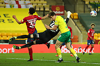 6th April 2021; Carrow Road, Norwich, Norfolk, England, English Football League Championship Football, Norwich versus Huddersfield Town; Joel Pereira of Huddersfield Town punches the ball away from Jordan Hugill of Norwich City