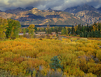 749450296 low clouds block portions of the teton range with fall colored grasses in the foreground from blacktail ponds grand tetons national park wyoming