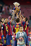 FC Barcelona's Neymar Santos Jr, Daniel Alves, Leo Messi and Adriano Correia celebrate with Neymar Santos Jr's son the victory in the Spanish King's Cup Final match. May 30,2015. (ALTERPHOTOS/Acero)