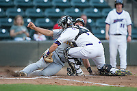 Winston-Salem Dash catcher Brett Austin (7) applies the tag to Daniel Salters (12) of the Lynchburg Hillcats as he tries to score a run at BB&T Ballpark on April 28, 2016 in Winston-Salem, North Carolina.  The Dash defeated the Hillcats 4-1.  (Brian Westerholt/Four Seam Images)
