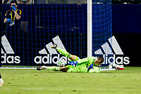 CARSON, CA - OCTOBER 18: Evan Bush #30 GK of the Vancouver Whitecaps makes a save during a game between Vancouver Whitecaps and Los Angeles Galaxy at Dignity Heath Sports Park on October 18, 2020 in Carson, California.