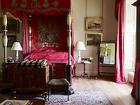Regal bed hangings in the King's Room are perks of an 18th century diplomatic posting