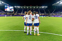 ORLANDO, FL - JANUARY 22: Emily Sonnett #14, Tierna Davidson #12, Jane Campbell #24, Alana Cook #28 and Ali Krieger #11 of the USWNT huddle before a game between Colombia and USWNT at Exploria stadium on January 22, 2021 in Orlando, Florida.