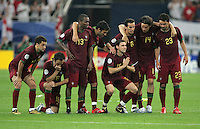 The Portuguese team watches hopefully as England takes a penalty kick.  Portugal defeated England on penalty kicks after playing to a 0-0 tie in regulation in their FIFA World Cup quarterfinal match at FIFA World Cup Stadium in Gelsenkirchen, Germany, July 1, 2006.