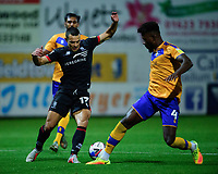 Lincoln City's Ramirez Howarth vies for possession with Mansfield Town's Rollin Menayese<br /> <br /> Photographer Andrew Vaughan/CameraSport<br /> <br /> EFL Trophy Northern Section Group E - Mansfield Town v Lincoln City - Tuesday 6th October 2020 - Field Mill - Mansfield  <br />  <br /> World Copyright © 2020 CameraSport. All rights reserved. 43 Linden Ave. Countesthorpe. Leicester. England. LE8 5PG - Tel: +44 (0) 116 277 4147 - admin@camerasport.com - www.camerasport.com