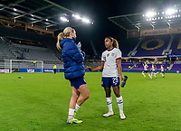 ORLANDO, FL - JANUARY 18: Lindsey Horan #9 talks with Catarina Macario #29 of the USWNT after a game between Colombia and USWNT at Exploria Stadium on January 18, 2021 in Orlando, Florida.