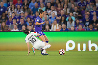 Orlando, FL - Saturday March 24, 2018: Orlando Pride defender Carson Pickett (16) tries to avoid the slide tackle by Utah Royals midfielder Diana Matheson (10) during a regular season National Women's Soccer League (NWSL) match between the Orlando Pride and the Utah Royals FC at Orlando City Stadium. The game ended in a 1-1 draw.