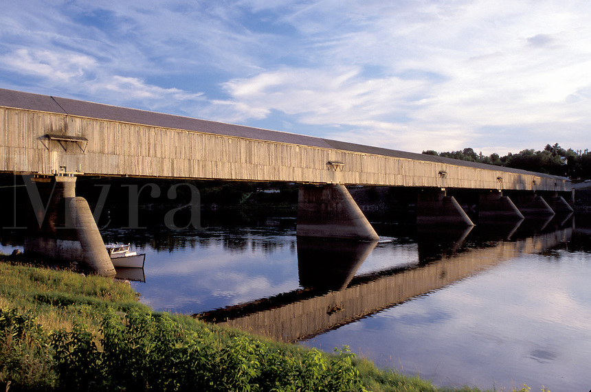 covered bridge, New Brunswick, Hartland, NB, Canada, World's Longest Covered Bridge (1282 ft.) reflects in the calm water of St. John's River in the town of Hartland.