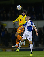 Aaron Holloway of Wycombe Wanderers & Mark McChrystal of Bristol Rovers go up for the ball during the Johnstone's Paint Trophy match between Bristol Rovers and Wycombe Wanderers at the Memorial Stadium, Bristol, England on 6 October 2015. Photo by Andy Rowland.