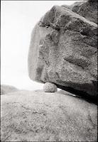 Smaller rock between two larger boulders<br />