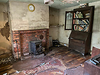 BNPS.co.uk (01202 558833)<br /> Pic: Symonds&Sampson/BNPS<br /> <br /> An abandoned cottage that is covered by undergrowth and looks like something out of a horror film has sold for a whopping £430,000.<br /> <br /> The derelict property, called Grasshopper Cottage, had a valuation of £275,000 before it went up for sale at auction.<br /> <br /> But due to the current state of the property market where demand far outstrips supply, interest and bidding in the 150-year-old cottage took off.