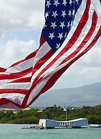 An American flag flying near the USS Arizona Memorial, Pearl Harbor, Oahu