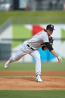 Birmingham Barons starting pitcher Lincoln Henzman (15) follows through on his delivery against the Pensacola Blue Wahoos at Regions Field on July 7, 2019 in Birmingham, Alabama. The Barons defeated the Blue Wahoos 6-5 in 10 innings. (Brian Westerholt/Four Seam Images)