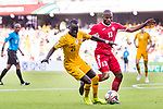 Khalil Baniateyah of Jordan (R) competes for the ball with Awer Mabil of Australia during the AFC Asian Cup UAE 2019 Group B match between Australia (AUS) and Jordan (JOR) at Hazza Bin Zayed Stadium on 06 January 2019 in Al Ain, United Arab Emirates. Photo by Marcio Rodrigo Machado / Power Sport Images