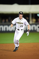 UCF Knights right fielder Eli Putnam (34) runs the bases after hitting a home run during a game against the Siena Saints on February 17, 2017 at UCF Baseball Complex in Orlando, Florida.  UCF defeated Siena 17-6.  (Mike Janes/Four Seam Images)