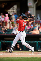 Erie SeaWolves center fielder Mike Gerber (17) follows through on a swing during a game against the Akron RubberDucks on August 27, 2017 at UPMC Park in Erie, Pennsylvania.  Akron defeated Erie 6-4.  (Mike Janes/Four Seam Images)