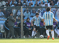 Argentina coach Diego Maradona watches as Lionel Messi and Carlos Tevez combine to build their team's attack. Argentina defeated South Korea, 4-1, in both teams' second match of play in Group B of the 2010 FIFA World Cup. The match was played at Soccer City in Johannesburg, South Africa June 17th.