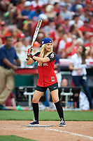 Olivia Holt bats during the All-Star Legends and Celebrity Softball Game on July 12, 2015 at Great American Ball Park in Cincinnati, Ohio.  (Mike Janes/Four Seam Images)