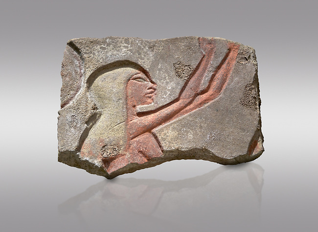 Ancient Egyptian Talatat block with a female worhiper of tambourine player relief, sandstone, New Kingdom, 18th Dynasty (1353-1336 BC), Thebes, Karnac. Egyptian Museum, Turin. Grey background.<br /> <br /> The talatat was introduced to increase the speed new monuments to Aten could be built. The talatat were smaller, about 52x26x24 cm, than the usual building blocks used and therfore were easier to handle and build with. They were first used on the new buildings of Akhenaten at Thebes during his reign, the, after his capital was moved , for the monumenta of Amarna. When Amon was restored all the Aten temples were taken down and their blocks used in other buildings. Over 100,000 talatat have been excavated so far in Thebes and they represent a massive jigsaw puzzle as archaeologist try to piece them together into their original reliefs.