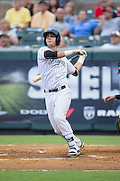 Victor Rey (14) of the Pulaski Yankees follows through on his swing against the Elizabethton Twins at Calfee Park on July 25, 2016 in Pulaski, Virginia.  The Twins defeated the Yankees 6-1.  (Brian Westerholt/Four Seam Images)