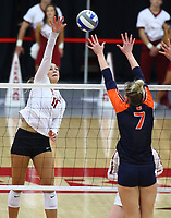 Arkansas Junior Maggie Cartwright (11) hits the ball over net against Auburn Junior Rebekah Rath (7) on Sunday, Oct. 10, 2021, during play at Barnhill Arena, Fayetteville. Visit nwaonline.com/211011Daily/ for today's photo gallery.<br /> (Special to the NWA Democrat-Gazette/David Beach)