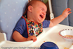 14 month old toddler girl in high chair tantrum crying horizontal