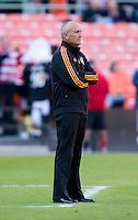 Houston Dynamo head coach Dominic Kinnear watches his team during a Major League Soccer game at RFK Stadium in Washington, DC. D.C. United vs. Houston Dynamo, 2-1.