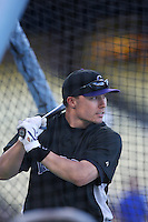Jeff Baker of the Colorado Rockies during batting practice before a game against the Los Angeles Dodgers in a 2007 MLB season game at Dodger Stadium in Los Angeles, California. (Larry Goren/Four Seam Images)