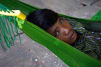 Young Boy having a rest in his hanging mat Tonle Sap Lake Cambodia