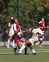 Boston College forward Natalie Crutchfield (9) blocks progress of Florida State midfielder Casey Short (3). Florida State University defeated Boston College, 1-0, at Newton Soccer Field, Newton, MA on October 31, 2010.